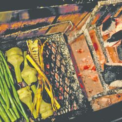 Vegetables sit on a wood-burning grill at the Gran Dabbang restaurant.