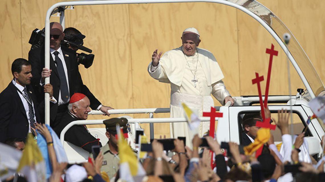 Pope Francis arrives to celebrate Mass at O'Higgins Park in Santiago.