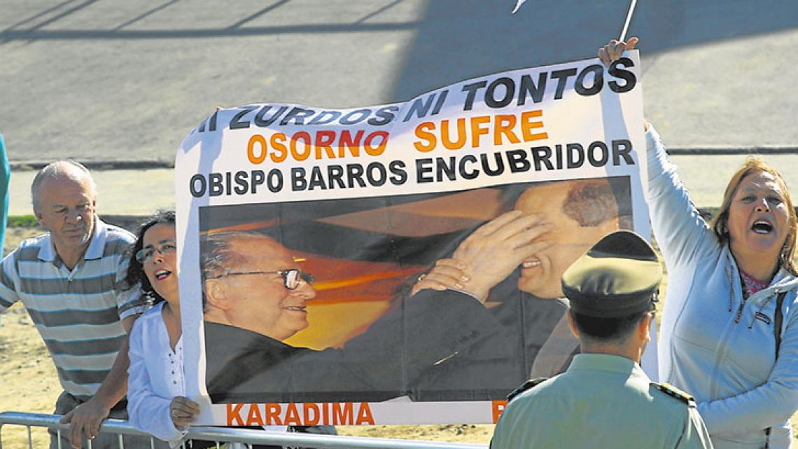 Protesters demonstrate against the Reverend Fernando Karadima, and his protege Juan Barros, bishop of Osorno, as Pope Francis rides past on his way to celebrates Mass at the Maquehue Airport in Temuco, Chile, on Wednesday.
