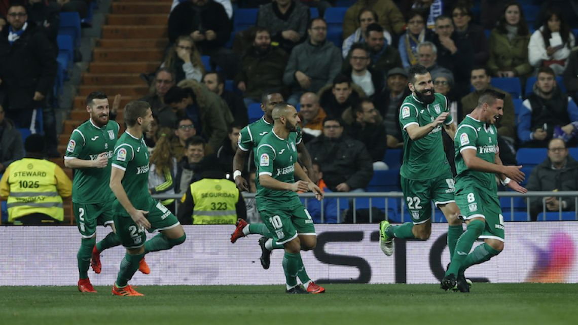 Leganes player Gabriel Appelt, right, celebrates with teammates after scoring his team's second goal against Real Madrid during the Copa del Rey quarterfinal second leg at the Santiago Bernabeu stadium on Wednesday.