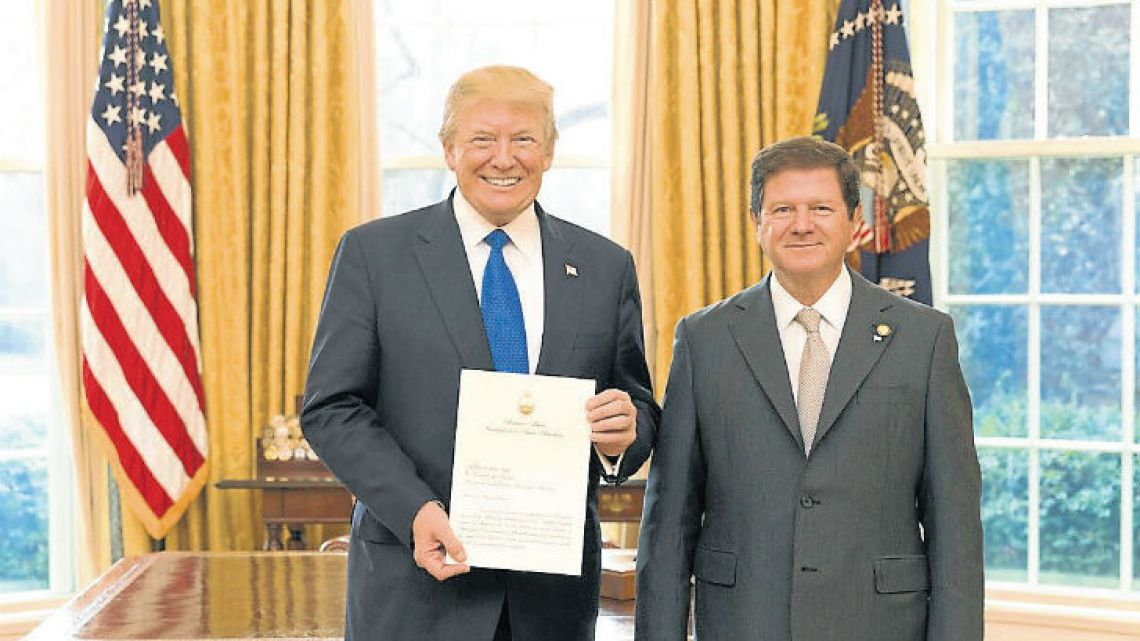 Argentine Ambassador Fernando Oris de Roa presents his credentials to US President Donald Trump, at the Oval Office in the White House, in Washington earlier this week.