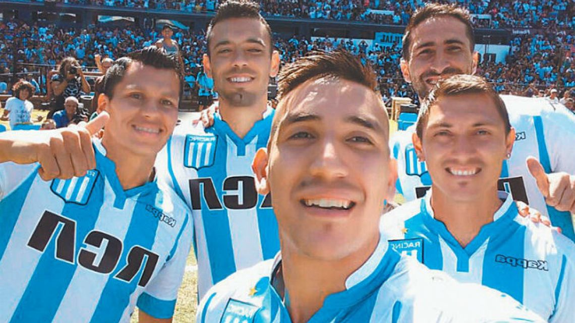 Racing Club's new signing, Ricardo Centurión (centre), takes a selfie with his new teammates during a presentation showing off the club's new signings to the fans.