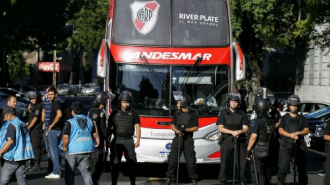 The River Plate team bus waits ahead of kickoff on Sunday while officials secure the Huracán stadium in response to a bomb threat.
