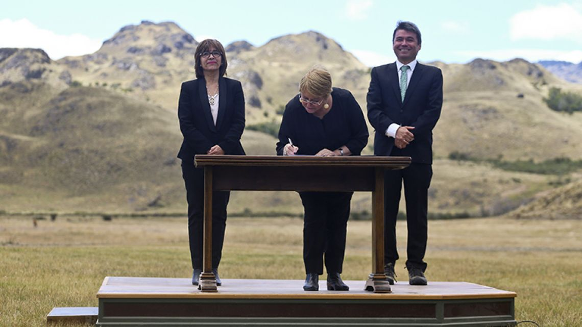 Chilean President Michelle Bachelet signs decrees creating vast new national parks using lands donated by the Tompkins Conservation, in what is believed to be the largest private donation of land ever from a private entity to a country, at a ceremony in Patagonia Park, Chile.