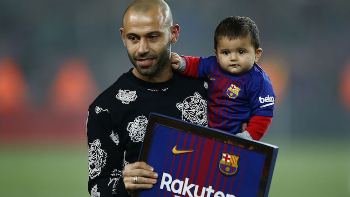 Javier Mascherano holds his son during his official farewell with Barcelona, held prior to the Copa del Rey quarterfinal second leg against Espanyol last Thursday. Mascherano has signed with Chinese Super League outfit Hebei China Fortune after eight years at Barcelona.