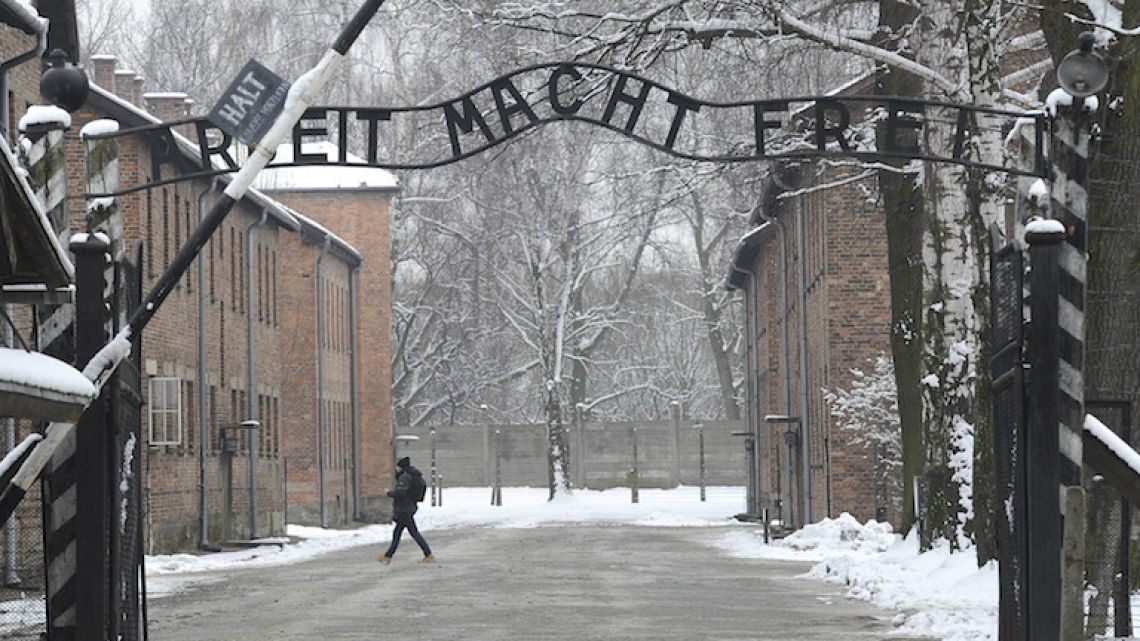 The entrance to the former Nazi Death Camp Auschwitz with the