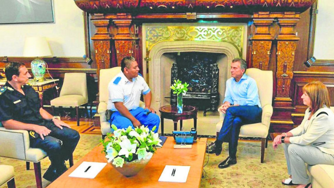 Chocobar with Macri and Bullrich