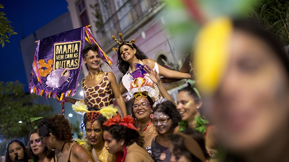"In this February 3, 2018 photo, women take part in the block party ""Maria vem com as outras,"" or ""Maria, join the other women,"" in Rio de Janeiro, Brazil."