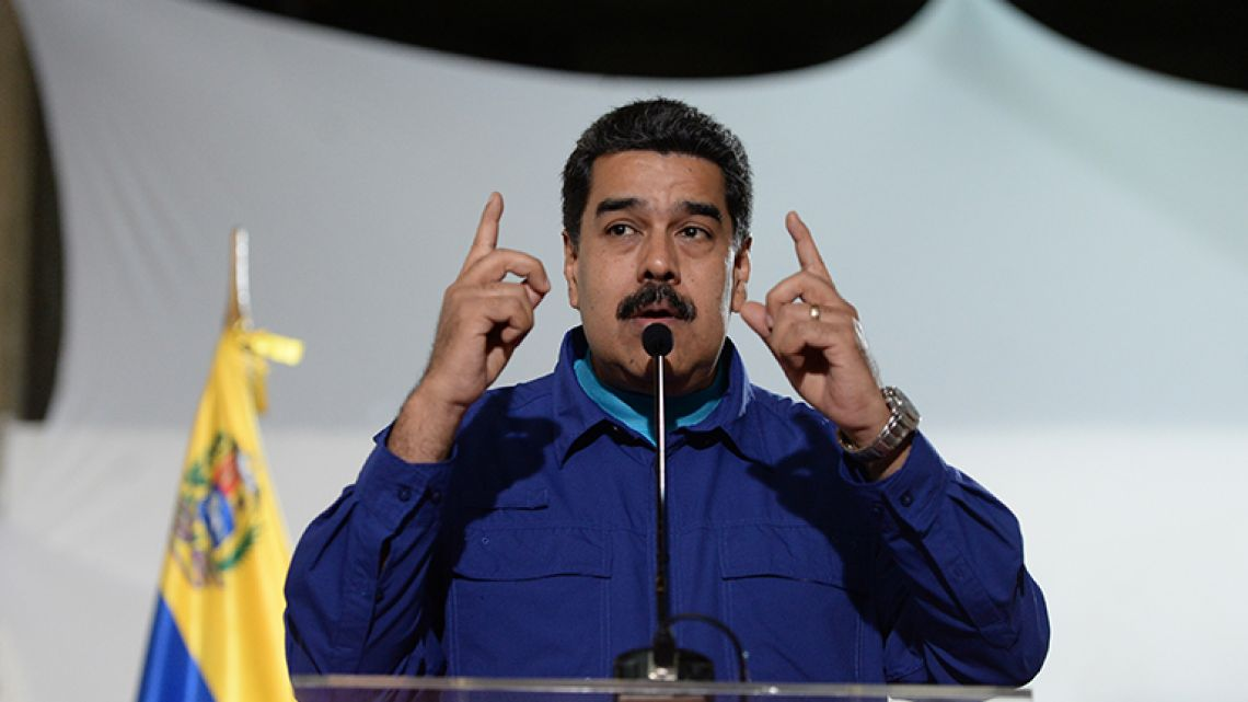 This file photo taken on February 7, 2018 shows Venezuelan President Nicolas Maduro speaking to the press before attending a rally in Caracas.