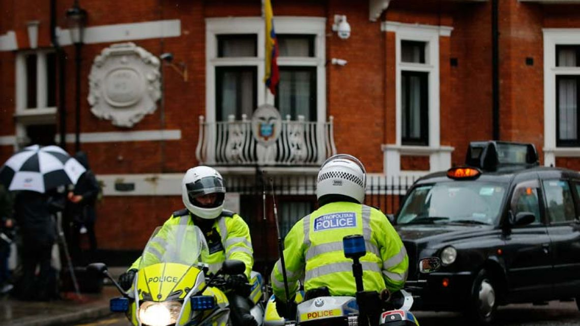 Police motorcyclists briefly stop outside the Ecuadorean Embassy in London this morning. A British judge has decided to uphold an arrest warrant for WikiLeaks founder Julian Assange, who has spent more than five years evading the law inside Ecuador's London Embassy.