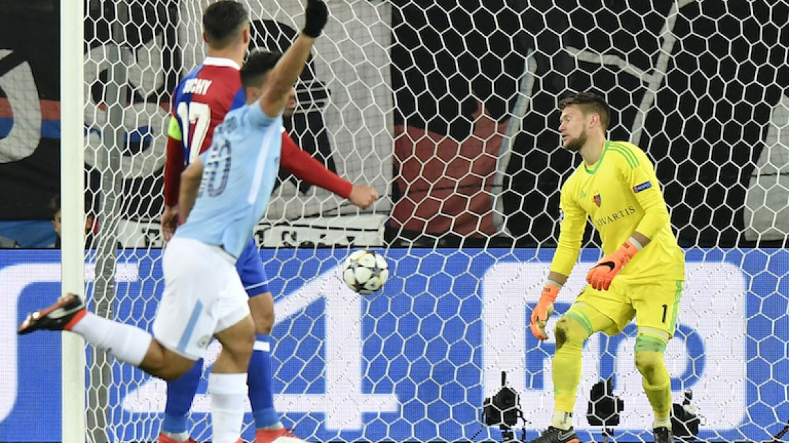 Sergio Agüero celebrates after scoring Manchester City's third goal against Basel in the Champions League round of 16 first leg match on Tuesday night.