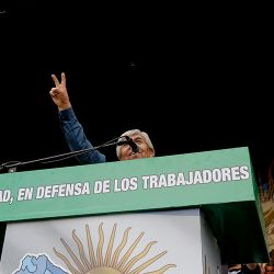 """Union leader Hugo Moyano delivers a speech against the government's austerity measures. The slogan on the podium reads: """"Unity in defense of the workers."""