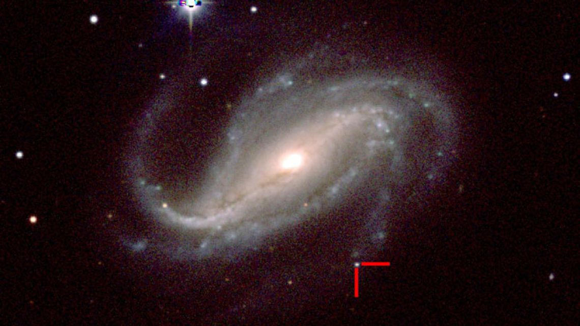 The newfound supernova 2016gkg (red cross), which is located about 80 million light-years from Earth in the galaxy NGC 613, as photographed by a group of University of California, Santa Cruz astronomers on February 18, 2017, at the Las Campanas Observatory in Chile.