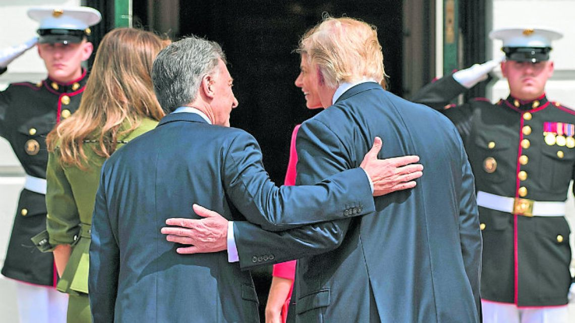 US President Donald Trump and President Mauricio Macri walking along.