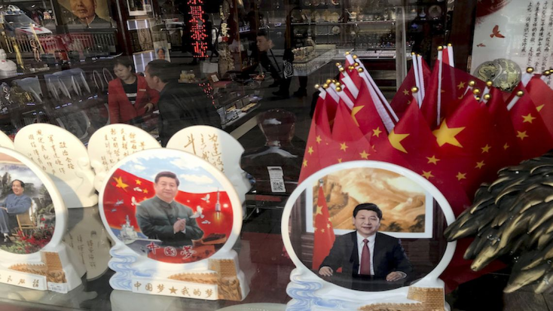 Memorabilia featuring Chinese President Xi Jinping displayed at a souvenir shop in Beijing.