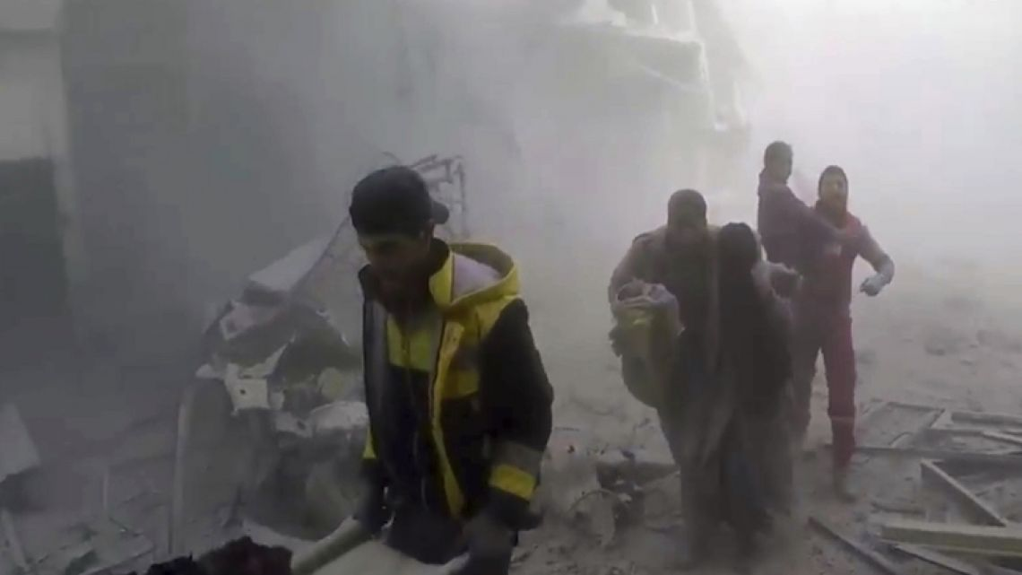 A screen-shot of a video released on Sunday by the Syrian civil defense group the White Helmets shows members of the group helping residents of Ghouta, a Damascus suburb, during airstrikes and shelling by Syrian government forces.