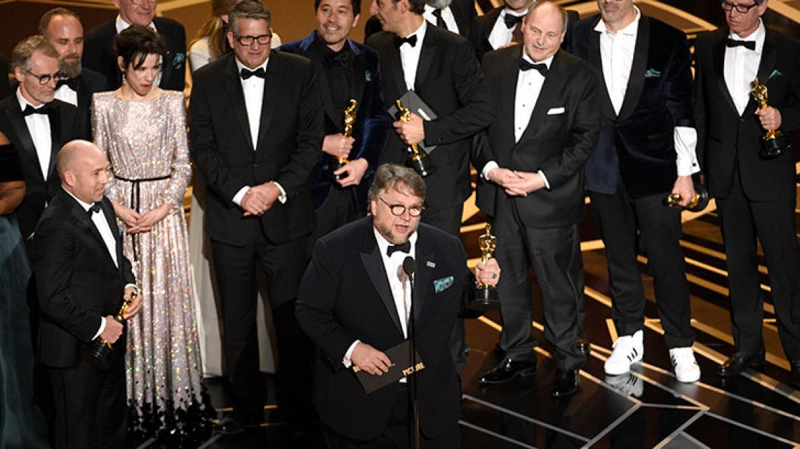 "Guillermo del Toro and the cast and crew of ""The Shape of Water"" accept the award for best picture at the Oscars on Sunday."