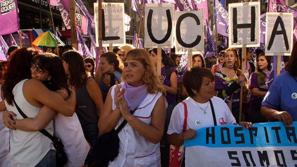 Women in Argentina gather for a women's rights march.