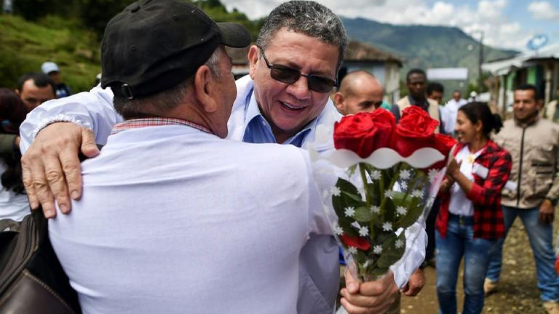 Pablo Catatumbo (R), a former leader of Colombia's largest guerrilla group, is now a candidate for the senate, seen here stumping for votes in a mountainous area where he once fought.