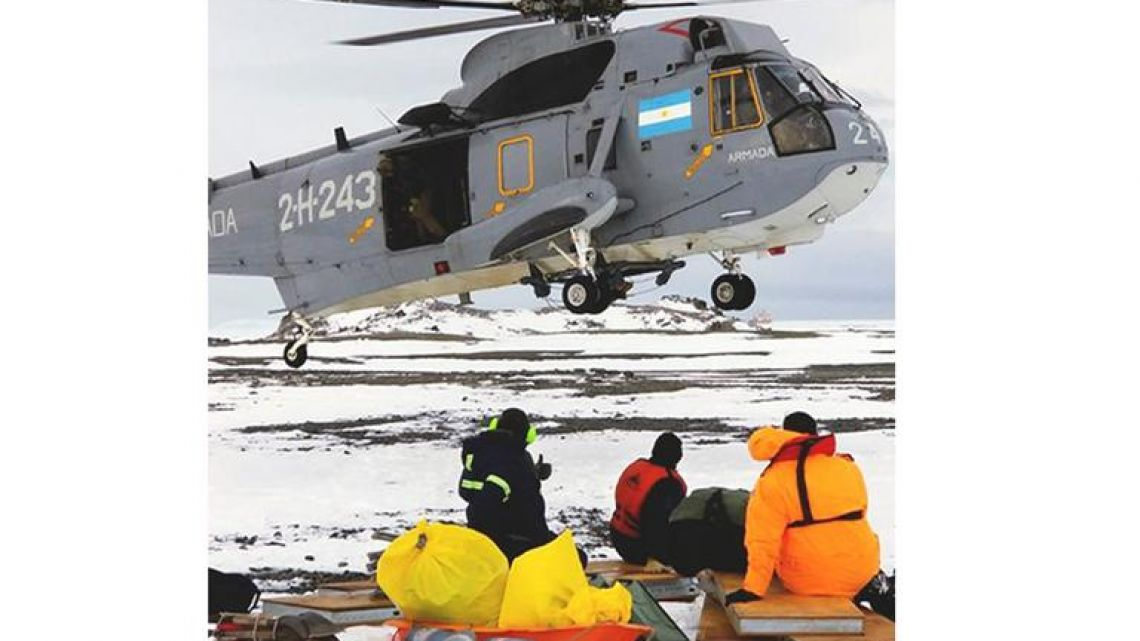 An Argentina helicopter landing to rescue stranded US scientists on Joinville Island in Antarctica, south of the Argentine mainland.