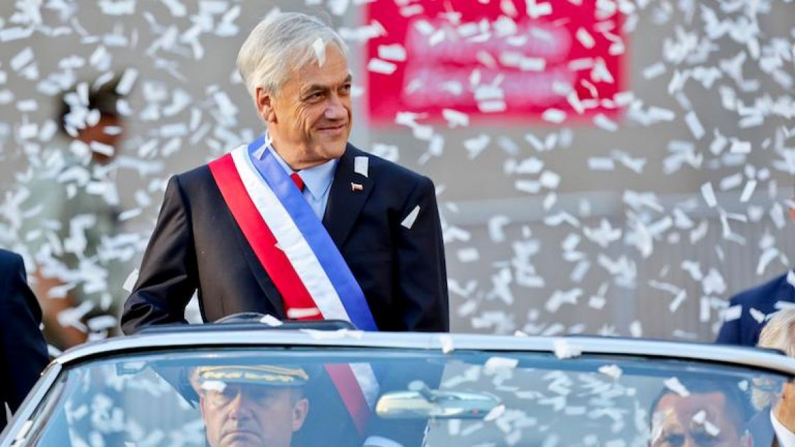 Chilean President Sebastian Piñera is showered with confetti as he rides in an open car to La Moneda presidential palace for his inauguration ceremony on Sunday.