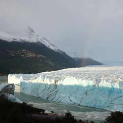 A rainbow is seen over the Perito Moreno glacier at Parque Nacional Los Glaciares near El Calafate, in the Argentine province of Santa Cruz, on March 12, 2018.