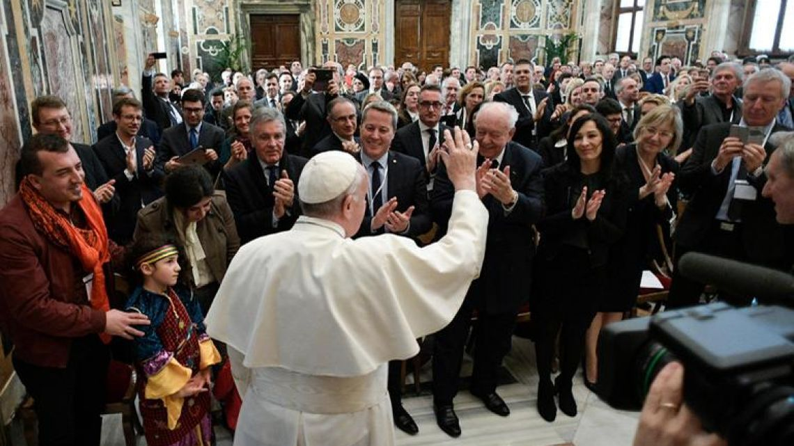 This handout picture released by the Vatican press office shows Pope Francis during an audience to the French parliamentarians and politicians of the Province of Marseille, on March 12, 2018 at the Vatican.