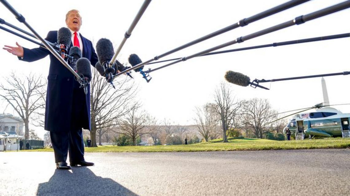 US President Donald Trump speaks to reporters before leaving on a two day trip to California and St. Louis on Tuesday morning.