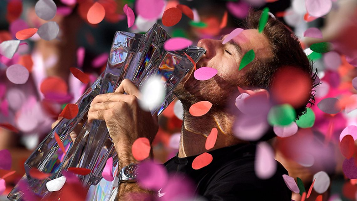 Juan Martin del Potro, of Argentina, kisses the trophy after defeating Roger Federer, of Switzerland, during the men's final at the BNP Paribas Open tennis tournament Sunday, March 18, 2018, in Indian Wells, Calif