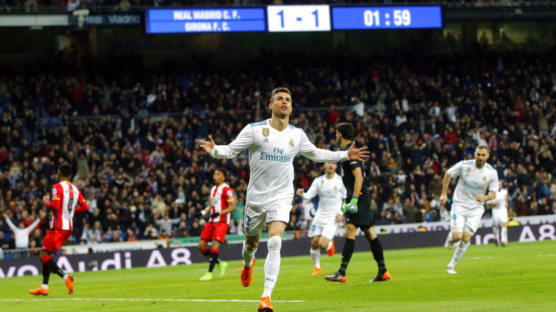Cristiano Ronaldo celebrates after scoring the second of four goals for Real Madrid in their league match against Girona on Sunday.