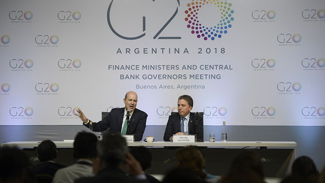 Central Bank President Federico Sturzenegger (left) and Treasury Minister Nicolás Dujovne deliver a press conference during the G20 Meeting of Finance Ministers and Central Bank Governors in Buenos Aires.