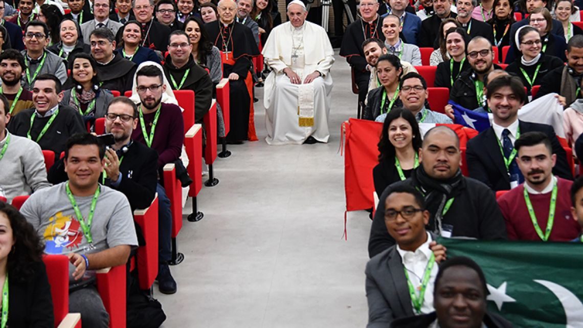 Pope Francis (centre) looks on as he sits with students during a pre-synodal meeting at Collegio Maria Mater Ecclesiae in Rome on March 19, 2018.