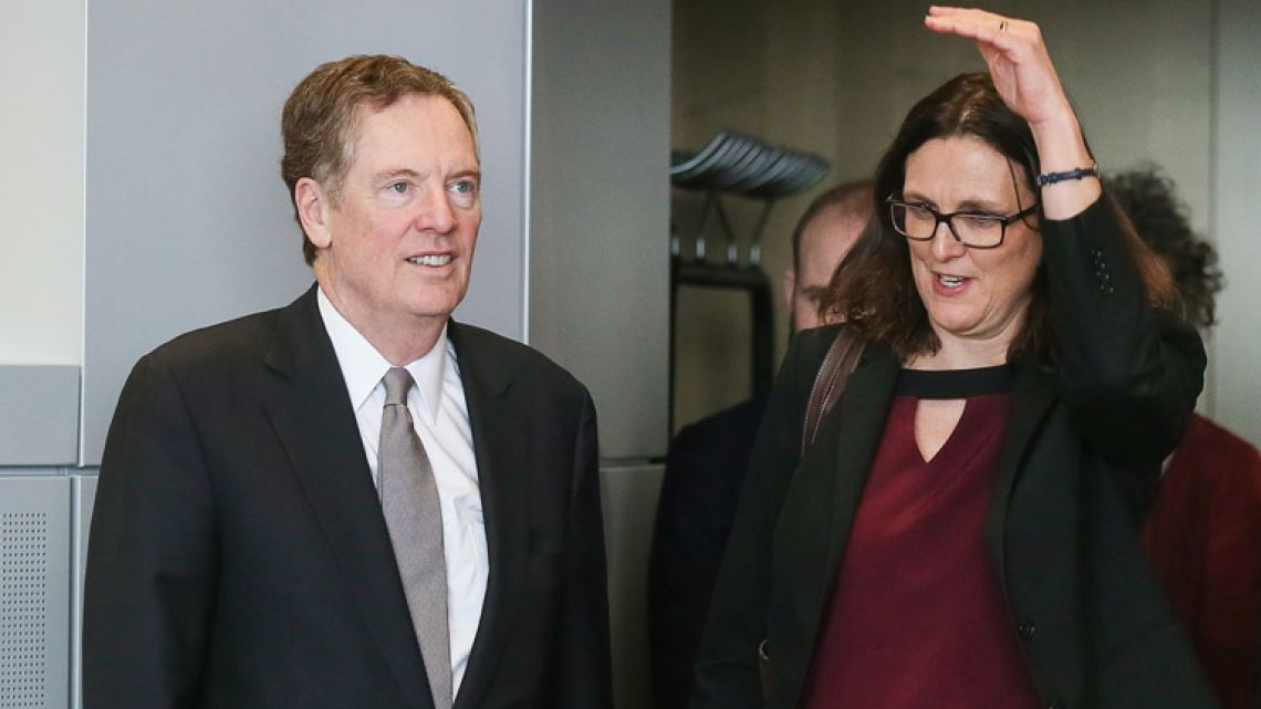 European Commissioner for Trade Cecilia Malmstrom (right) and US trade representative Robert Lighthizer arrive for a meeting for talks in Brussels, earlier this month.