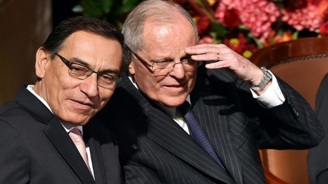 In this file picture from 2016 Peruvian President Pedro Pablo Kuczynski (R) and Vice-President Martin Vizcarra are pictured at a ceremony in Lima.