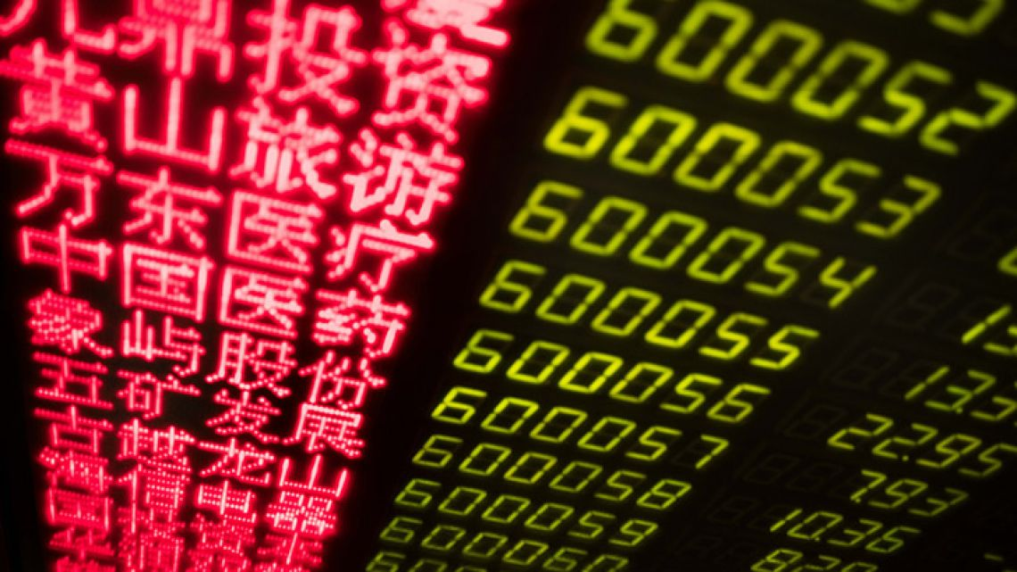 Stock price movements are seen on a screen at a securities company in Beijing on March 23, 2018.