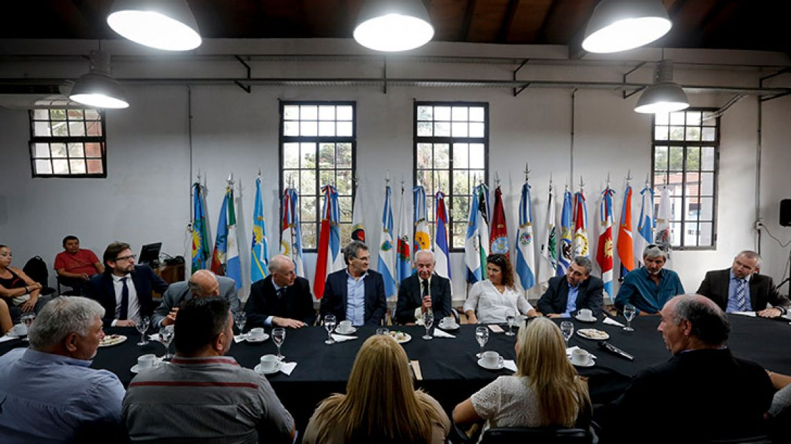Former British Army officer Geoffrey Cardozo, centre, talks during a meeting with government officials in Buenos Aires on Friday. Cardozo, a young British Army captain during the 1982 South Atlantic war who recovered and reburied the fallen Argentine soldiers on the islands, was honoured by the Argentine government and relatives of some of the fallen soldiers.