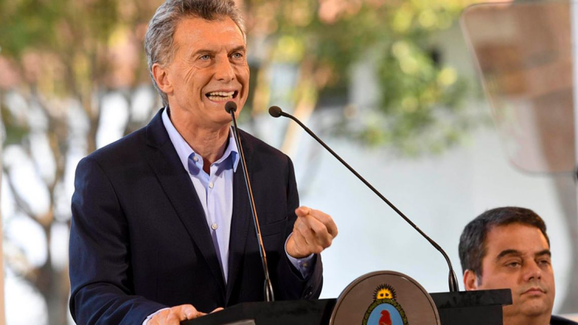 President Mauricio Macri gives a press conference at the Olivos presidential residence, earlier this afternoon.