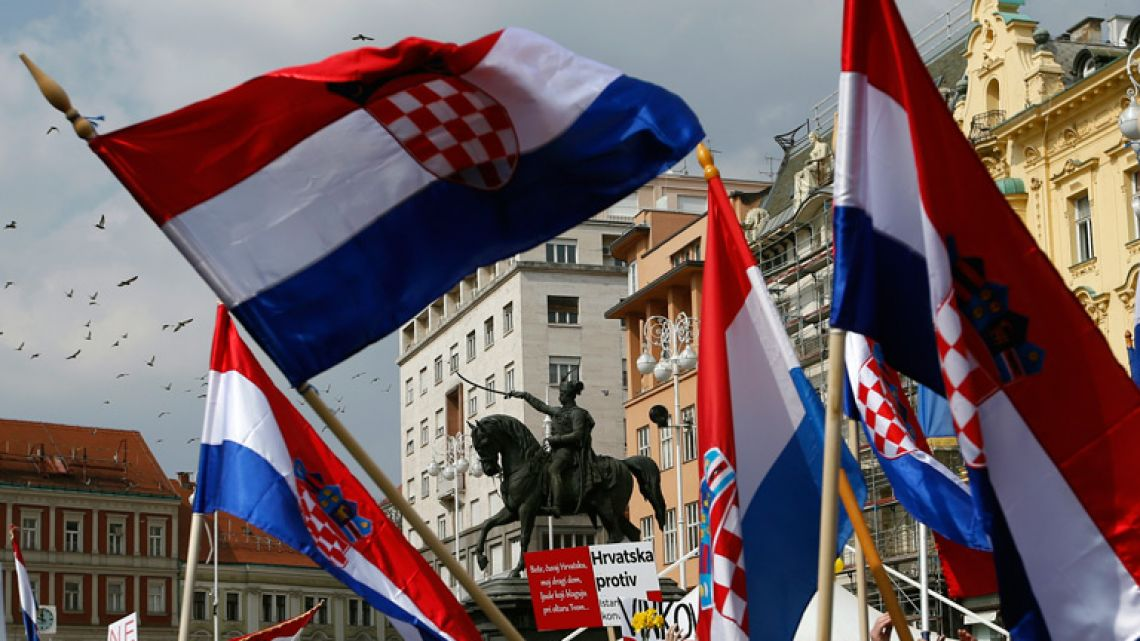 People wave Croatian flags during a protest against an international convention they say indirectly legalises gay marriages and gives rights to transgender people, in Zagreb, Croatia.