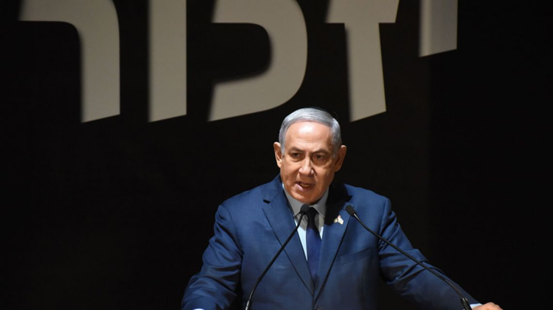 Israeli Prime Minister Benjamin Netanyahu speaks at the official ceremony for Israel's Remembrance Day for fallen soldiers in the Mt. Herzl Military Cemetery in Jerusalem on April 18, 2018.