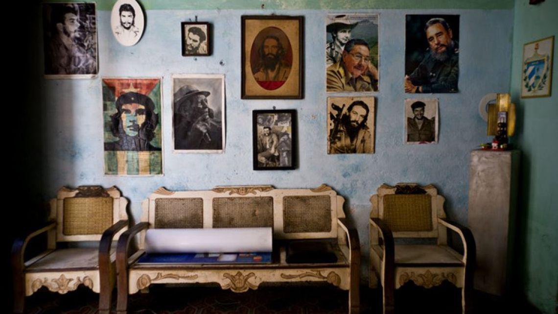 Images of revolutionary hero Ernesto 'Che' Guevara, Camilo Cienfuegos, Fidel Castro, Raúl Castro, and singer Compay Segundo, adorn a wall, in Havana, Cuba.
