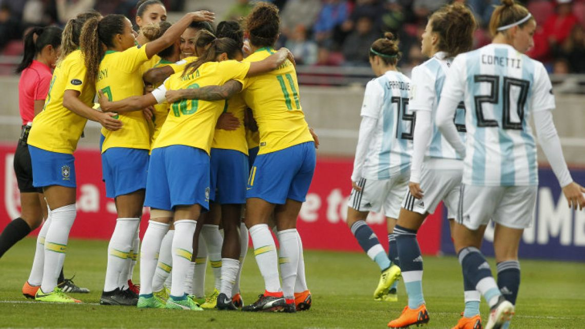Brazil's players celebrate after Thaisa scored against Argentina, during the women's Copa América semi final football match in La Serena, Chile on April 19.