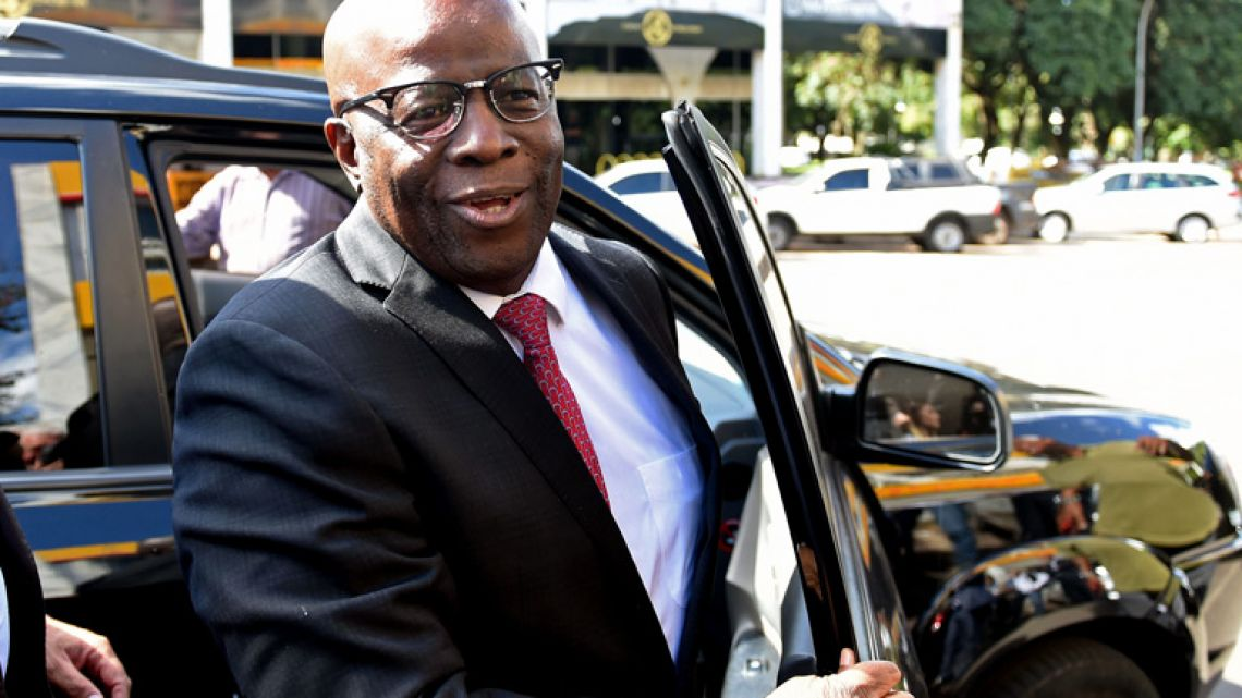 Former Supreme Court judge Joaquim Barbosa arrives at the headquarters of the Brazilian Socialist Party (PSB) in Brasilia.