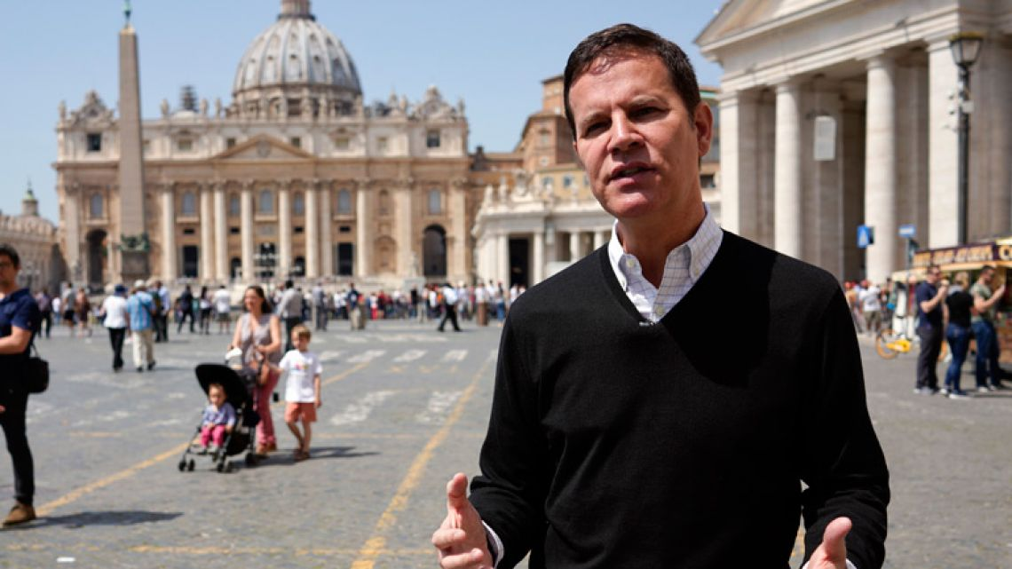 """Juan Carlos Cruz, backdropped by St.Peter's Basilica, in Rome. Cruz, who is the key whistleblower in Chile's clerical sex abuse scandal, has arrived in Rome for his audience with Pope Francis and says he will urge Francis to get rid of the """"toxic"""" bishops and cardinals who have defamed and discredited him and other abuse survivors around the world."""