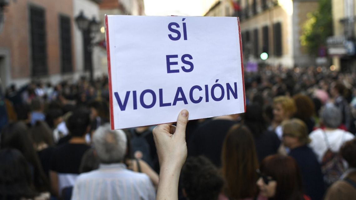 "A person holds up a placard reading ""Yes it is rape"" during a demonstration in Madrid today."