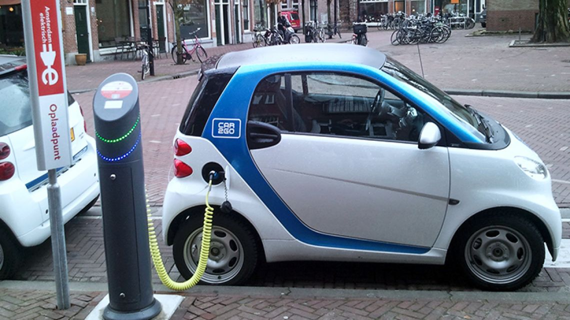 An electric car recharges in Amsterdam, the Netherlands.