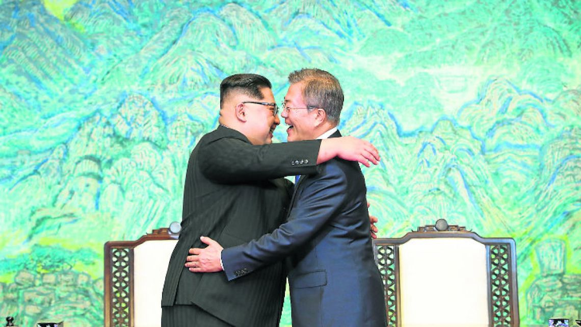North Korean leader Kim Jong-un (left) and South Korean President Moon Jae-in embrace each other after signing a joint statement at the border village of Panmunjom in the Demilitarised Zone, South Korea, yesterday.