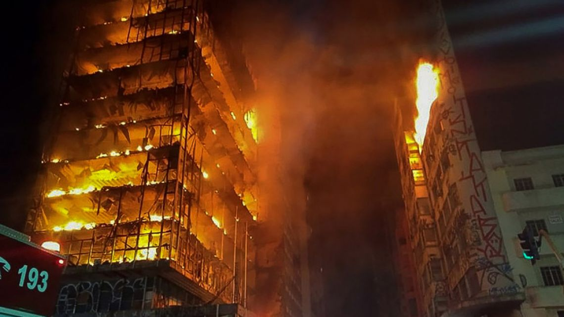 This handout photo released by the São Paulo Fire Department on May 1, 2018 shows flames engulfing a building in the city centre of São Paulo. A 24-storey building in the center of Sao Paulo, Brazil's biggest city, collapsed early May 1 after a blaze that rapidly tore through the structure, reportedly killing one person.