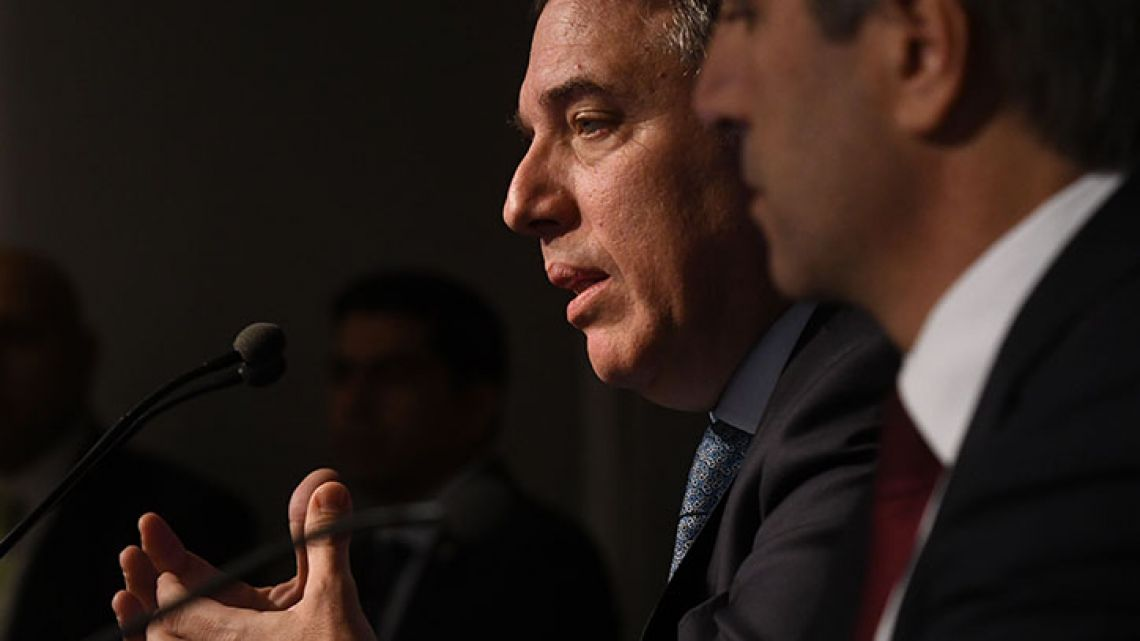 Treasurer Nicolás Dujovne speak during a press conference.