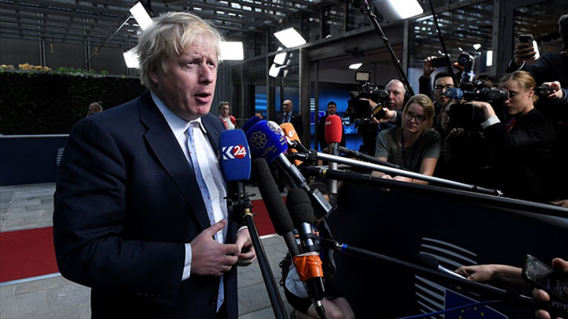 British Foreign Secretary Boris Johnson answers journalists' questions before a ministerial meeting of EU/E3 and EU/E3 with Iran at the EU headquarters in Brussels on May 15, 2018.