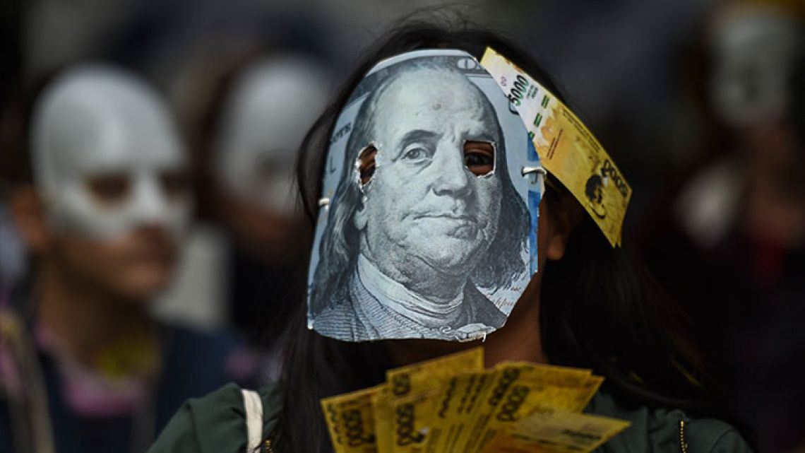 A person demonstrates against the rise of public services fares and the government's negotiations with the International Monetary Fund (IMF), in Buenos Aires, on May 14, 2018.